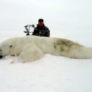 Trophy Hunters In The Arctic Pose Beside Endangered Slaughtered Polar Bears