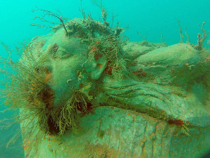 Art And Biodiversity Have Been Brought Back To Life in an Italian Lake With Fisherman's Underwater Sculptures